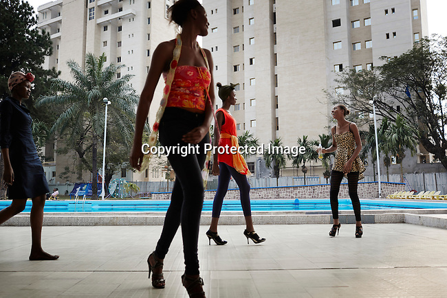 KINSHASA, DRC - JULY 17: Models rehearse a day before Kinshasa Fashion Week on July 17, 2014, at Shark club in Kinshasa, DRC. Local and invited foreign-based designers showed their collections during the second edition of Kinshasa Fashion week. (Photo by Per-Anders Pettersson)