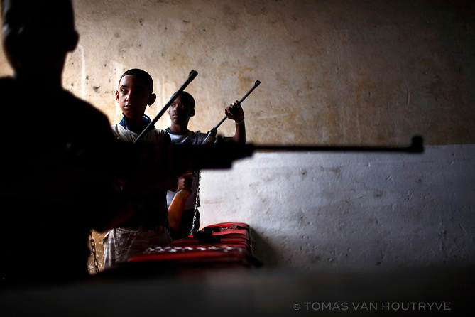 Young Cuban boys fire pellet guns at a shooting range in Havana, Cuba on 26 October 2008.