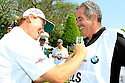 Ernie Els of South Africa has Sam Torrance caddie for him in the ProAm prior to the first  round of the BMW PGA Championship played on the West Course, Wentworth Club, Virginia Water, Surrey, England 24 - 27 May 2012. (Picture Credit / Phil Inglis)