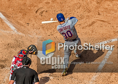 30 April 2017: New York Mets outfielder Michael Conforto hits an RBI single in the 4th inning for the Mets' 5th run against the Washington Nationals at Nationals Park in Washington, DC. The Nationals defeated the Mets 23-5 in the third game of their weekend series. Mandatory Credit: Ed Wolfstein Photo *** RAW (NEF) Image File Available ***