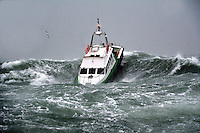 BNPS.co.uk (01202) 558833<br /> Picture: Frank Kowalski<br /> <br /> This is the terrifying moment a boat is smashed head on by a monster wave - forcing the craft to travel through the wave - before bursting out the back of it to safety. The 48ft pilot vessel was pummelled by the enormous breaking wave as violent storms battered the UK coastline over the festive period. Incredibly the boat's two-man crew from Safe Haven Marine had deliberately taken it out in the horrendous Force 11 storm to put it through its paces in Cork Harbour in Ireland.