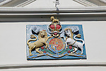 Lion and unicorn royal coat of arms 'Dieu et mon Droit' motto of monarchy seen in Falmouth, Cornwall, England, UK