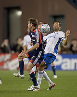 Goalie punt drops between New England Revolution midfielder Steve Ralston (14) and San Jose Earthquakes midfielder Ramiro Corrales (12). The New England Revolution defeated the San Jose Earthquakes, 2-0, in their first visit to Gillette Stadium on May 17, 2008.