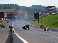 Jun 18, 2017; Bristol, TN, USA; NHRA top fuel driver Clay Millican (left) defeats Leah Pritchett to win the Thunder Valley Nationals at Bristol Dragway. Mandatory Credit: Mark J. Rebilas-USA TODAY Sports