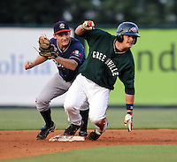 Second baseman Phil Gosselin (30) of the Rome Braves makes the tag to late on base-stealing Sean Kileen (12) of the Greenville Drive in a game on Aug. 10, 2010, at Fluor Field at the West End in Greenville, S.C. Photo by: Tom Priddy/Four Seam Images