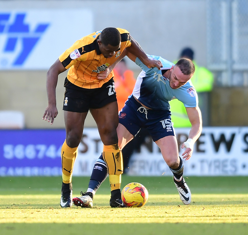 Cambridge United's Uche Ikpeazu vies for possession with Blackpool's Tom Aldred<br /> <br /> Photographer Chris Vaughan/CameraSport<br /> <br /> The EFL Sky Bet League Two - Cambridge United v Blackpool - Saturday 14th January 2017 - The Cambs Glass Stadium - Cambridge<br /> <br /> World Copyright &copy; 2017 CameraSport. All rights reserved. 43 Linden Ave. Countesthorpe. Leicester. England. LE8 5PG - Tel: +44 (0) 116 277 4147 - admin@camerasport.com - www.camerasport.com