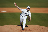Wingate Bulldogs relief pitcher Chris Macca (29) delivers a pitch to the plate against the Concord Mountain Lions at Ron Christopher Stadium on February 2, 2020 in Wingate, North Carolina. The Mountain Lions defeated the Bulldogs 12-11. (Brian Westerholt/Four Seam Images)