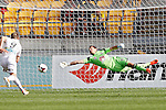 Phoenix's Glen Moss tries unsuccessfully to save a goal by the Perth Glory in the A-League football match at Westpac Stadium, Wellington, New Zealand, Sunday, March 09, 2014. Credit: Dean Pemberton