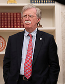 National Security Advisor John Bolton looks on as United States President Donald J. Trump meets with Gianni Infantino, President of Fédération Internationale de Football Association (FIFA) in the Oval Office of the White House in Washington, DC on Tuesday, August 28, 2018.  FIFA describes itself as an international governing body of association football, futsal, and beach soccer.<br /> Credit: Ron Sachs / CNP