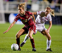 Kristen Mewis (19) of Boston College tries to keep the ball away from Annie Case (26) of Stanford during the second game of the NCAA Women's College Cup at WakeMed Soccer Park in Cary, NC.  Stanford defeated Boston College, 2-0.