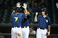Brian Sharp (7) of the Columbia Fireflies high fives teammate Wagner Lagrange (23) after hitting a 3-run home run against the Rome Braves at Segra Park on May 13, 2019 in Columbia, South Carolina. The Fireflies defeated the Braves 6-1 in game two of a doubleheader. (Brian Westerholt/Four Seam Images)