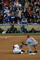 Ichiro Suzuki of Japan beats the throw at second base to Derek Jeter of the United States at the World Baseball Classic at Dodger Stadium on March 22, 2009 in Los Angeles, California. (Larry Goren/Four Seam Images)