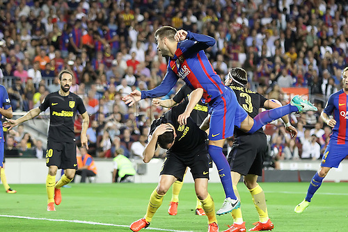 21.09.2016. Nou Camp, Barcelona, Spain. La Liga Football. Barcelona versus Athletico Madrid. Pique climbs over over Godin for the header