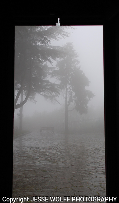 Looking out the door of an ancient church in Volastra, Italy during a rain storm.