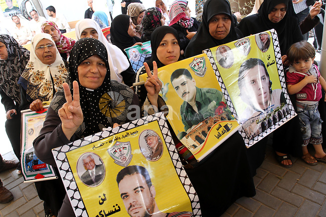 Palestinians women hold pictures of their prisoned relatives in Israeli jails as they gather in a weekly activity calling for their liberty at the Red Cross headquarters in Gaza City on Aug.1, 2011. About 7000 prisoners are in Israeli jails according to the Palestinian prisoners ministry. Photo by Mohammed Asad