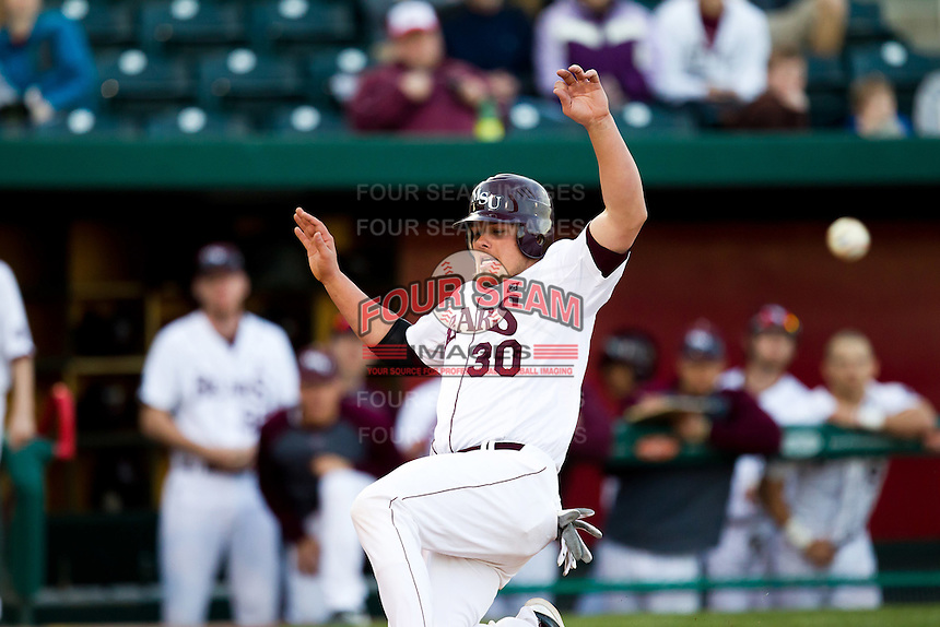 Luke Voit (30) of the Missouri State Bears tries to beat the ball to home plate during a game against the Oklahoma State Cowboys at Hammons Field on March 6, 2012 in Springfield, Missouri. (David Welker / Four Seam Images)