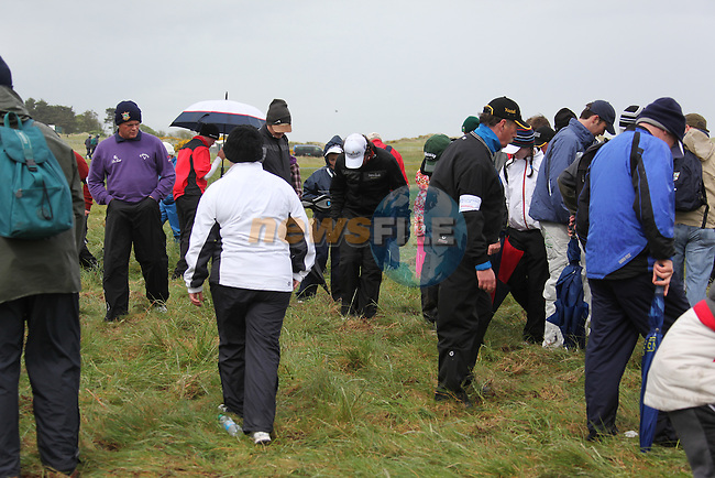 Rory McElroy helping to look for David Drysdales ball in the rough on the third after play restarted on day 3 at the 3 Irish open in Co Louth Golf Club...Photo: Fran Caffrey/www.golffile.ie..