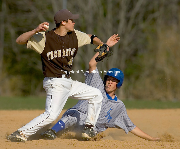 BURLINGTON, CT- 16 APRIL 2008 --041608JS07--Lewis Mills' Austin Atkinson(46) is called out on a force play at second as Thomaston's Kyle Capaldo (4) tries to turn a double play during their game Wednesday at Lewis S. Mills High School in Burlington. <br /> Jim Shannon / Republican-American