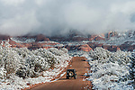 Jeep driving into the back country after a snowfall.  Sedona, AZ