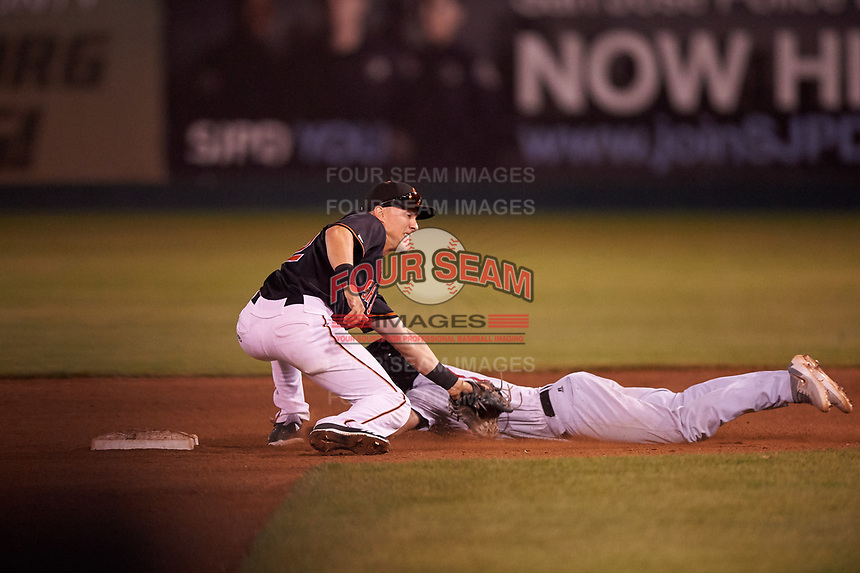 San Jose Giants second baseman Kyle McPherson (2) applies the tag to Jose Caballero (7) during a California League game against the Visalia Rawhide on April 12, 2019 at San Jose Municipal Stadium in San Jose, California. Visalia defeated San Jose 6-2. (Zachary Lucy/Four Seam Images)