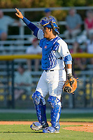 Catcher Edul Escobar #11 of the Burlington Royals signals that there are two outs in an exhibition game against the Kernersville Bulldogs at Burlington Athletic Stadium June20, 2010, in Burlington, North Carolina.  Photo by Brian Westerholt / Four Seam Images