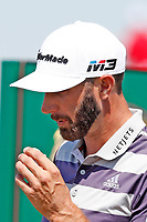 Dustin Johnson (USA) blows on his ball  before teeing off on the first hole during the third round of the 118th U.S. Open Championship at Shinnecock Hills Golf Club in Southampton, NY, USA. 16th June 2018.<br /> Picture: Golffile | Brian Spurlock<br /> <br /> <br /> All photo usage must carry mandatory copyright credit (&copy; Golffile | Brian Spurlock)
