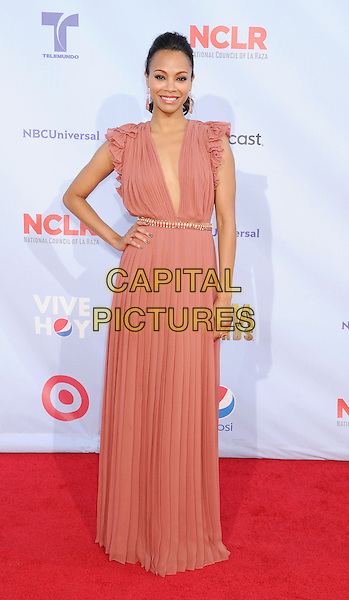 Zoe Saldana.2012 NCLR ALMA Awards - arrivals, held at The Pasadena Civic Auditorium, Pasadena, California USA..16th September 2012.full length dress belt pink plunging neckline hand on hip.CAP/ROT/TM.© TM/Roth/Capital Pictures