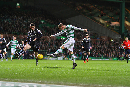 02.03.2016. Celtic Park, Glasgow, Scotland. Scottish Premier League. Celtic versus Dundee. Leigh Griffiths shot is blocked by defender Paul McGinn