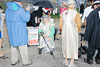 Supporters of campaign finance reform wait to march in the Labor Day Parade in Milford, New Hampshire, on Mon., September 2, 2019. Candidates Bernie Sanders and Vermin Supreme were the only candidates who marched in the parade this year.