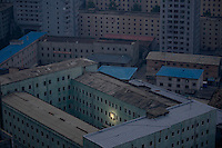 A picture of North Korea's founder Kim Il-sung decorates a building in the capital Pyongyang early October 5, 2011. REUTERS/Damir Sagolj (NORTH KOREA)