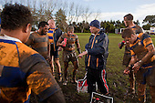 Nick Leger gives halftime instructions to his muddied players. Counties Manukau Premier Club Rugby game between Patumahoe & Karaka played at Patumahoe on Saturday June 13th 2009. Patumahoe lead 8 - 0 at halftime and went on to win 20 - 0.