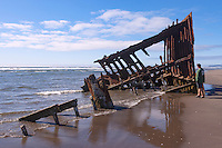The wreck of the Peter Iredale, a four-masted steel barque sailing vessel, sits in the sands of Clatsop Spit at the mouth of the Columbia River where it ran aground on October 25, 1906.