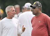 Ashburn, VA - August 6, 2009 -- Special Teams coach Denny Smith, left, discusses some strategy with Defensive coordinator Greg Blache, right,  during the 2009 Washington Redskins Training Camp at Redskins Park in Ashburn, Virginia on Thursday, August 6, 2009..Credit: Ron Sachs / CNP