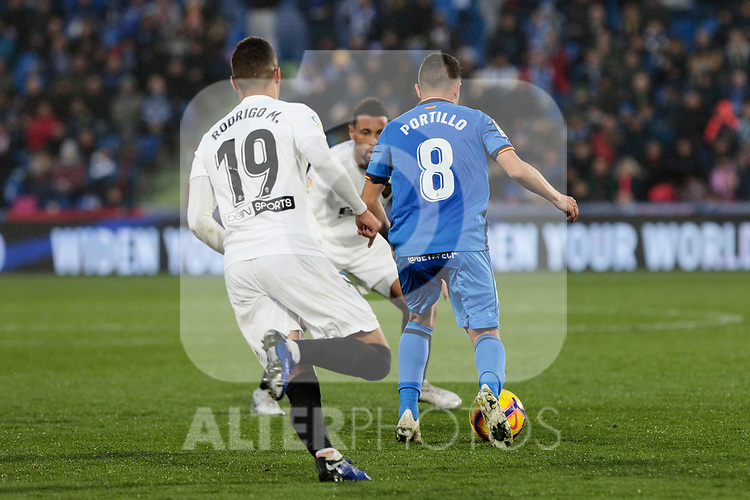 Getafe CF's Francisco Portillo and Valencia CF's Rodrigo Moreno during La Liga match between Getafe CF and Valencia CF at Coliseum Alfonso Perez in Getafe, Spain. November 10, 2018.