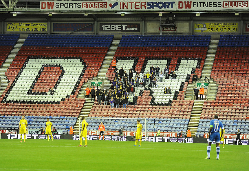 Maribor fans watch the match from the stands<br /> <br /> Photo by Stephen White/CameraSport<br /> <br /> Football - Europa League Group D - Wigan Athletic v Maribor - Thursday 3rd October 2013 - DW Stadium - Wigan<br /> <br /> &copy; CameraSport - 43 Linden Ave. Countesthorpe. Leicester. England. LE8 5PG - Tel: +44 (0) 116 277 4147 - admin@camerasport.com - www.camerasport.com