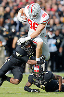 Ohio State Buckeyes tight end Jeff Heuerman (86) leaps over Purdue Boilermakers safety Taylor Richards (4) and defensive back Anthony Brown (9) during the first half of the NCAA football game at Ross-Ade Stadium in West Lafayette, Ind. on Nov. 2, 2013. (Adam Cairns / The Columbus Dispatch)