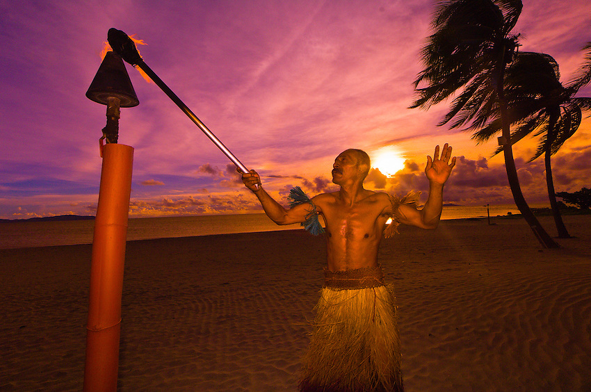tiki lighting. interesting lighting fijian man lighting tiki torches on beach at sunset westin resort and spa  denarau intended tiki lighting