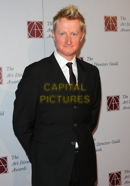 GUY HENDRIX DYAS .15th Annual Art Directors Awards held at The Beverly Hilton Hotel, Beverly Hills, California, USA, .5th February 2011.half length black suit tie white shirt .CAP/ADM/TC.©T. Conrad/AdMedia/Capital Pictures.