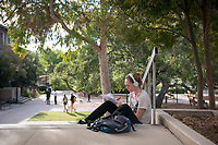 An Occidental College student studies outside the Norris Hall of Chemistry and Fowler Hall, next to the Academic Quad, Nov. 8, 2017. <br /> (Photo by Marc Campos, Occidental College Photographer)