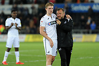 George Byers of Swansea City and Billy Reid, assistant manager for Swansea at full time during the Sky Bet Championship match between Swansea City and Derby County at the Liberty Stadium in Swansea, Wales, UK. Wednesday 01 May 2019