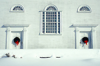 white church, doors, Vermont, VT, The doors of the Union Meeting House (1825) decorated with wreaths in the winter in Burke Hollow.