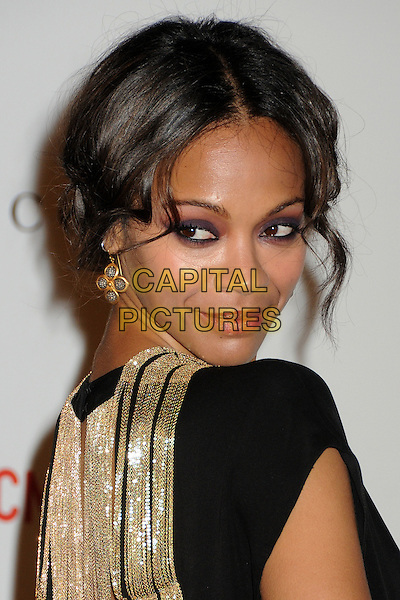 Zoe Saldana.The Inaugural Art and Film Gala held at LACMA in Los Angeles, California, USA..November 5th, 2011.headshot portrait black gold looking over shoulder .CAP/ADM/BP.©Byron Purvis/AdMedia/Capital Pictures.