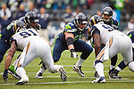 Seattle Seahawks offensive linemen Breno Giacomini (68) and J.Z. Sweezy battles St. Louis Rams defensive linemen Chris Long (91) and Lance Kendricks (88) during their game at CenturyLink Field in Seattle, Washington on December 29, 2013. The Seahawks clinched the NFC West title and home-field advantage throughout the playoffs with a 27-9 victory over the St. Louis Rams.  ©2013. Jim Bryant Photo. ALL RIGHTS RESERVED.