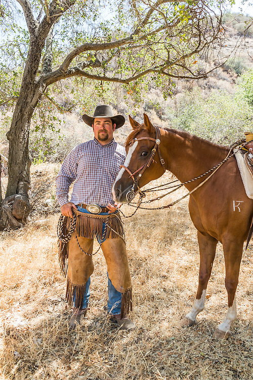 2016 Best Freelance Editorial Photograph - American Horse Publications<br /> 2nd Place:  &ldquo;Andy Camacho with Sin Derella WP Taking a Break&rdquo;<br /> Published in Arabian Horse World, November 2015<br /> What the judges said:<br /> &ldquo;Really nice portrait of man with his horse.  Framed well by trees.  Man's face is not hidden by shadow of his hat.  Good focus.&rdquo;