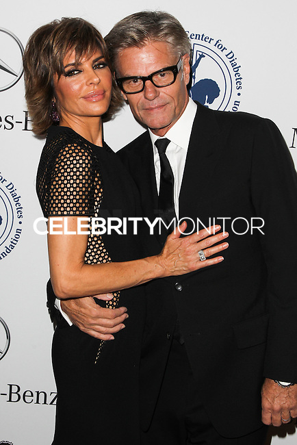 BEVERLY HILLS, CA, USA - OCTOBER 11: Lisa Rinna, Harry Hamlin arrive at the 2014 Carousel Of Hope Ball held at the Beverly Hilton Hotel on October 11, 2014 in Beverly Hills, California, United States. (Photo by Celebrity Monitor)