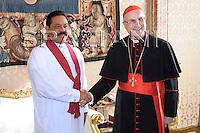 cardinal tarcisio Bertone;Pope Benedict XVI and Sri Lanka's President Mahinda Rajapaska meet during a private audience at the Vatican, Monday, Dec. 1, 2008..