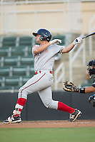 Tyler Spoon (15) of the Greenville Drive follows through on his swing against the Kannapolis Intimidators at Intimidators Stadium on June 7, 2016 in Kannapolis, North Carolina.  The Drive defeated the Intimidators 5-2 in game two of a double header.  (Brian Westerholt/Four Seam Images)