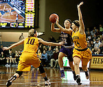 SIOUX FALLS, SD: FEBRUARY 28: 	Mariah Szymanski #22 from the University of Sioux Falls passes the ball away from Paige Waytashek #10 and Jessi Marti #34 from Northern State University in the Women's NSIC Championship Game at the Sanford Pentagon. (Photo by Dave Eggen/Inertia)