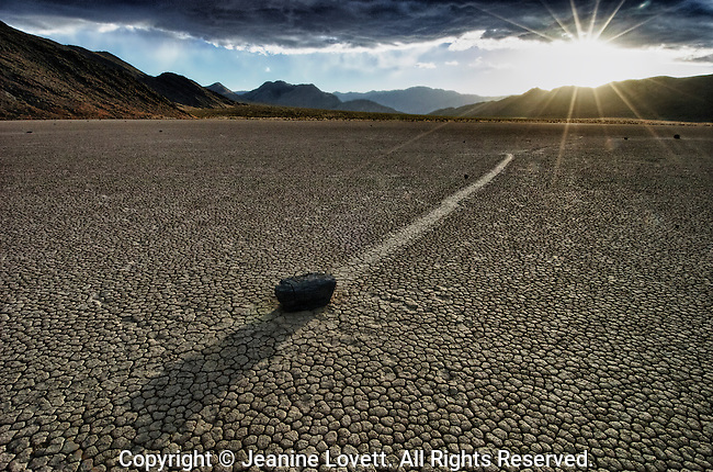 "The Racetrack, is a scenic dry lake feature with moving stones that leave linear ""racetrack"" imprints. This photo was taken on a windy and very cold winter day."