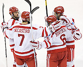 Chris Connolly (BU - 12), Max Nicastro (BU - 7), Alexx Privitera (BU - 6) and Wade Megan (BU - 18) celebrate Privitera's goal which made it 5-1 BU early in the third. - The Boston University Terriers defeated the visiting Providence College Friars 6-1 on Friday, January 20, 2012, at Agganis Arena in Boston, Massachusetts.